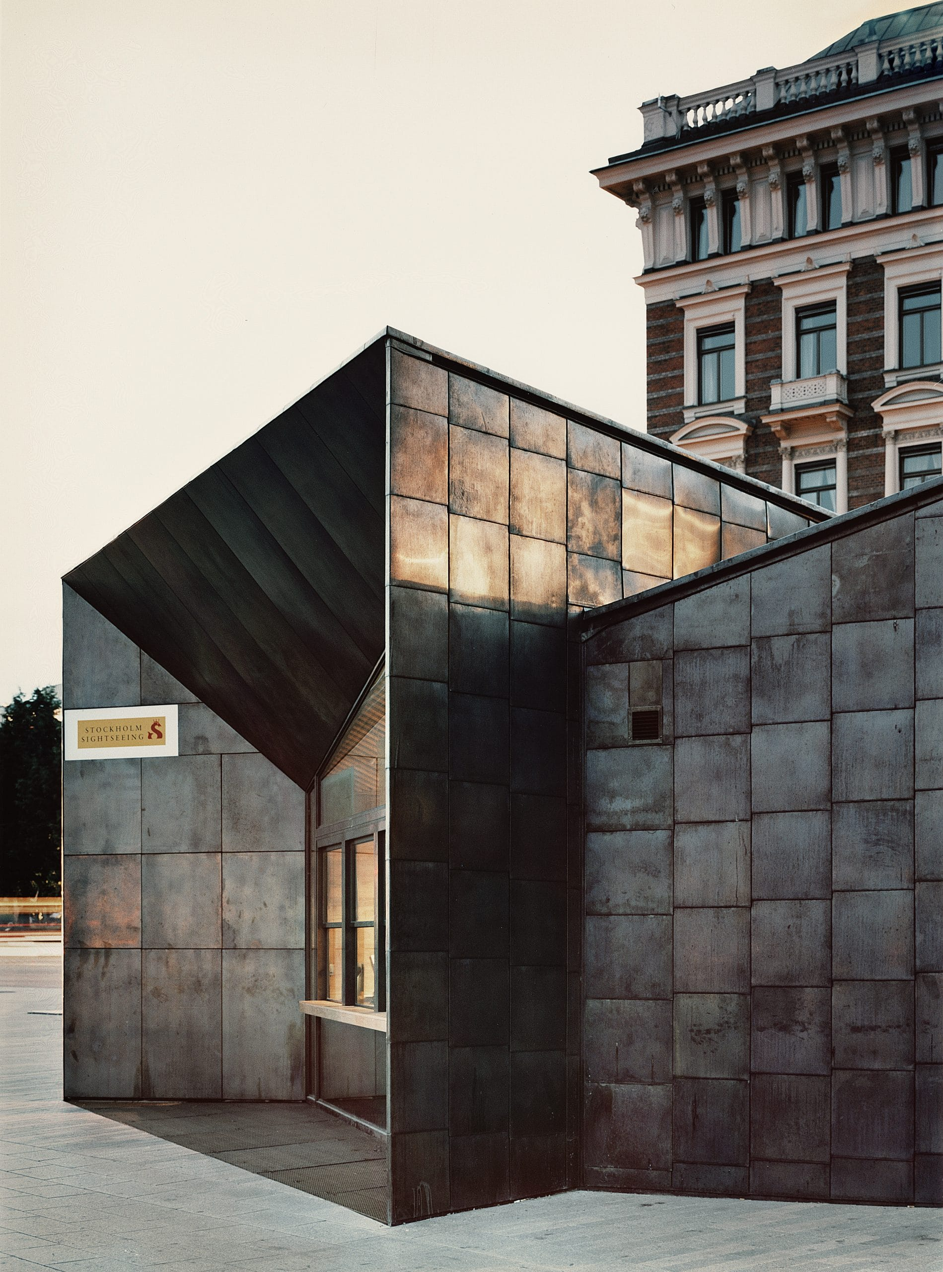 Entrance facade of Strimkajen Ferry Terminal in Sweden. Walls are made from Nordic Brass copper by Aurubis and Nordic Copper.