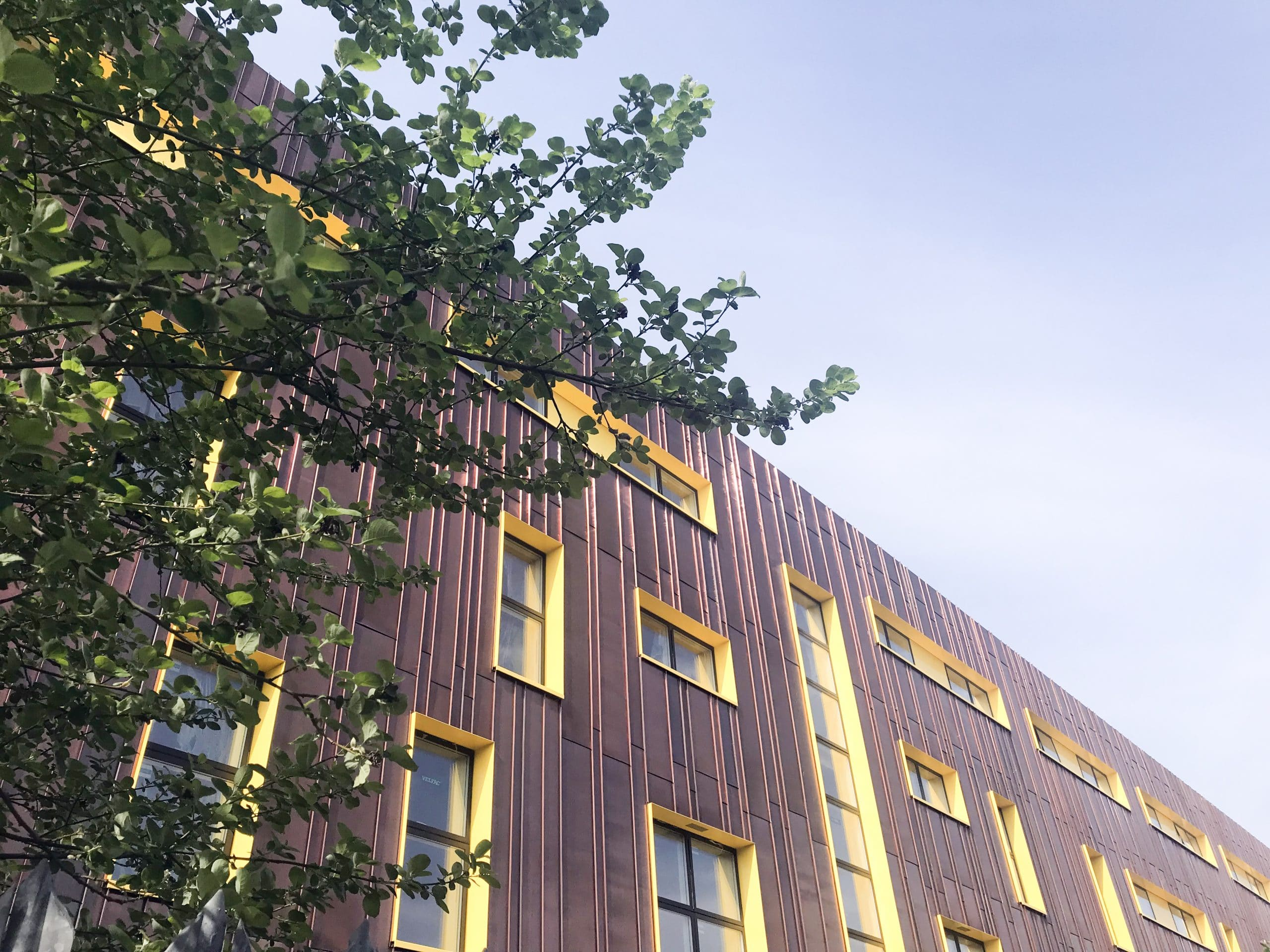 Main facade of the Copper Building located in Bristol, UK. Walls are clad from Nordic Brown copper.