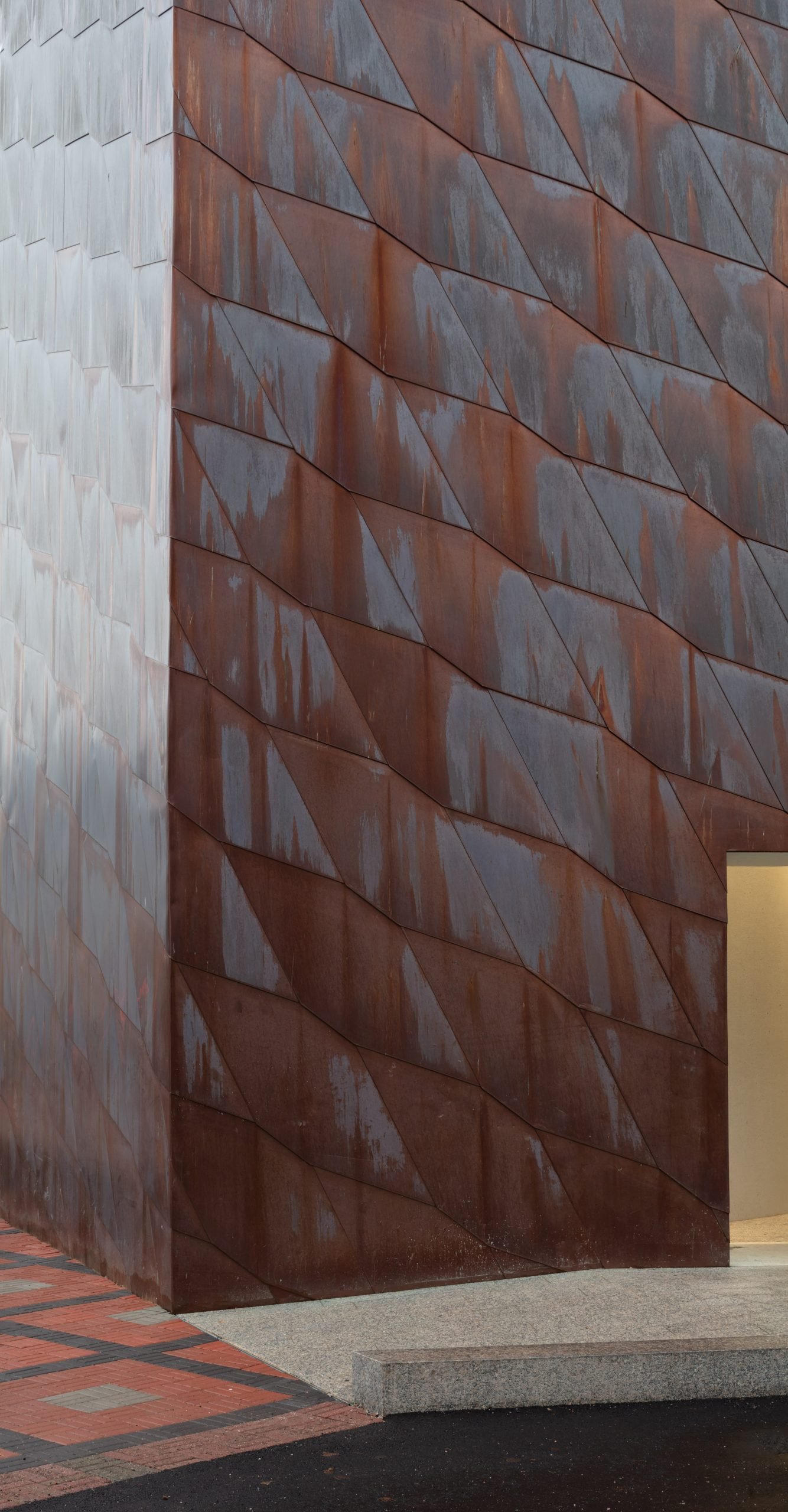 Close up view of the copper facade of Kirkkonummi Library in Finland. The facades are clad from Nordic Brown Light copper.