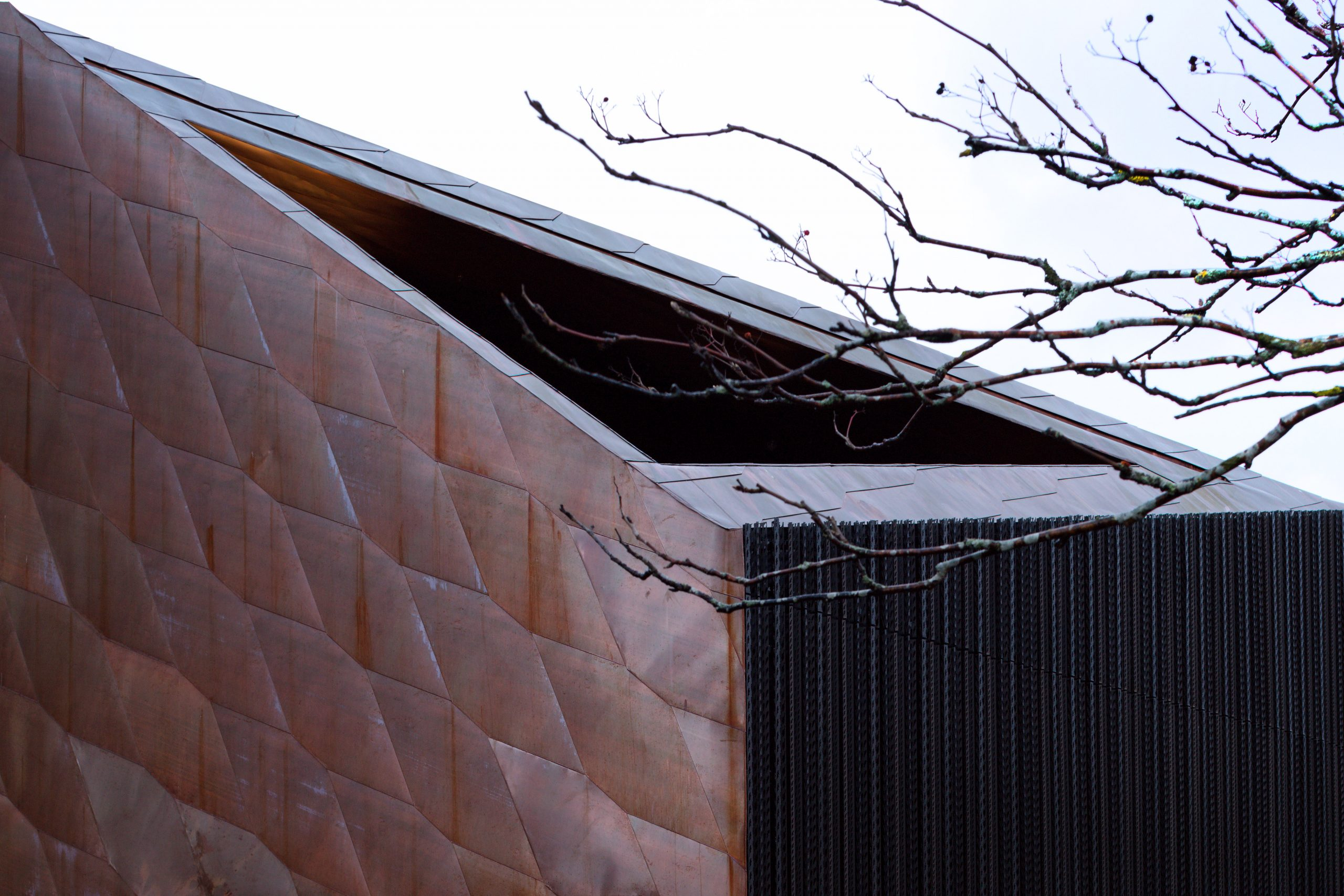 View of the walls and roof of the Kirkkonummi Library located in Finland. The brown-coloured walls are clad from Nordic Brown Light copper.