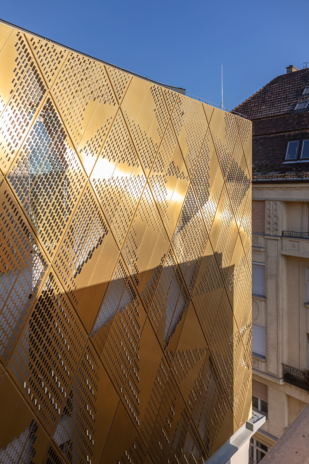 View of the corner of the facades of the Hard Rock Hotel located in Budapest, Hungary. The gold-coloured walls are clad from Nordic Royal copper.