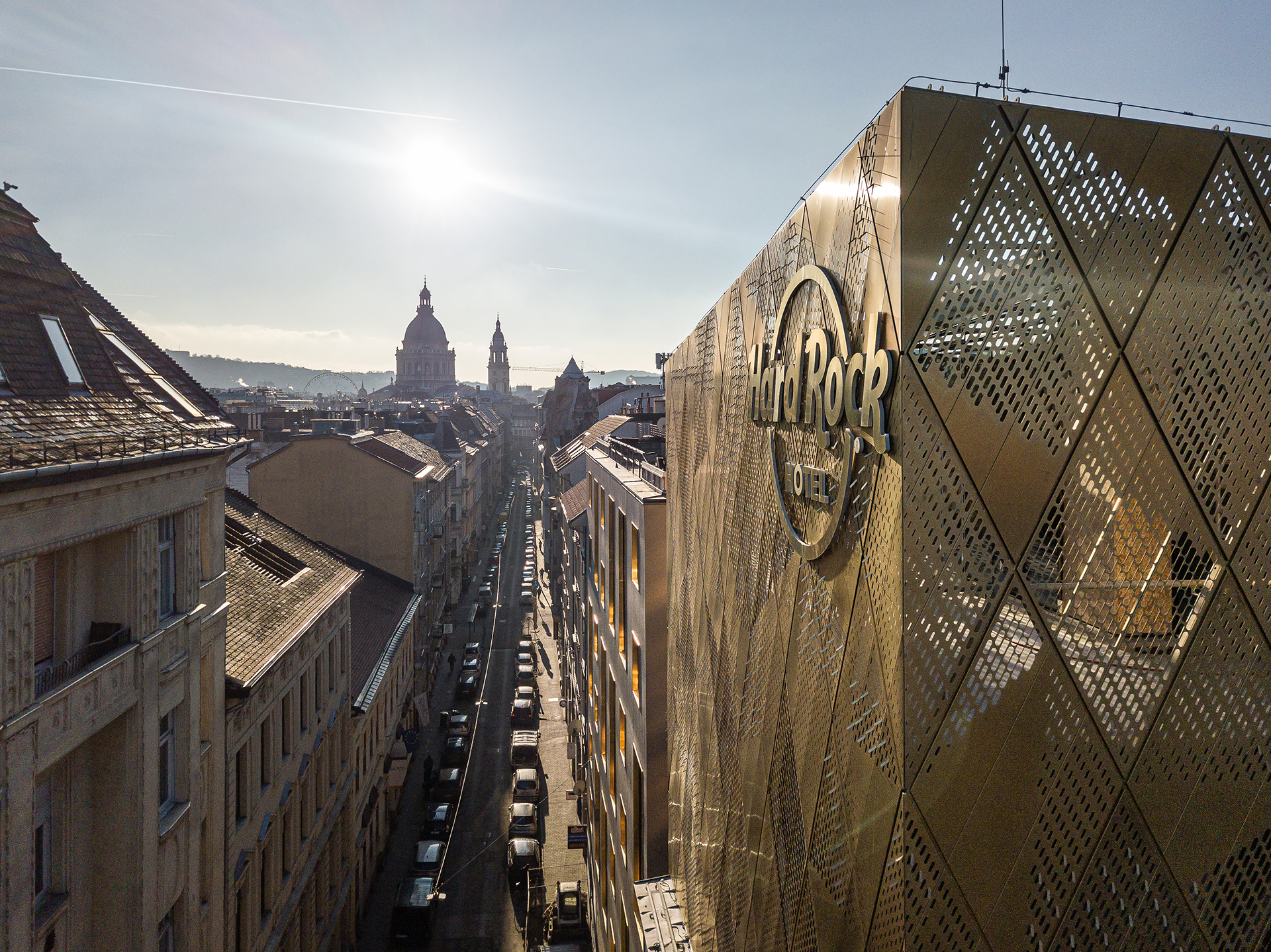View showcasing Hard rock hotel and the street it's located on. Some Budapest buildings are visible. The hotel's walls are clad from Nordic Royal copper.