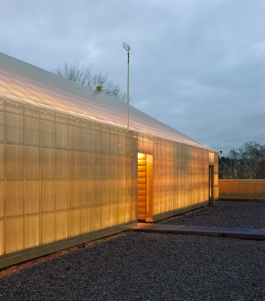 Close view of the gold-coloured walls of SHK Museum in Stockholm, Sweden. The walls are clad from Nordic Royal copper.