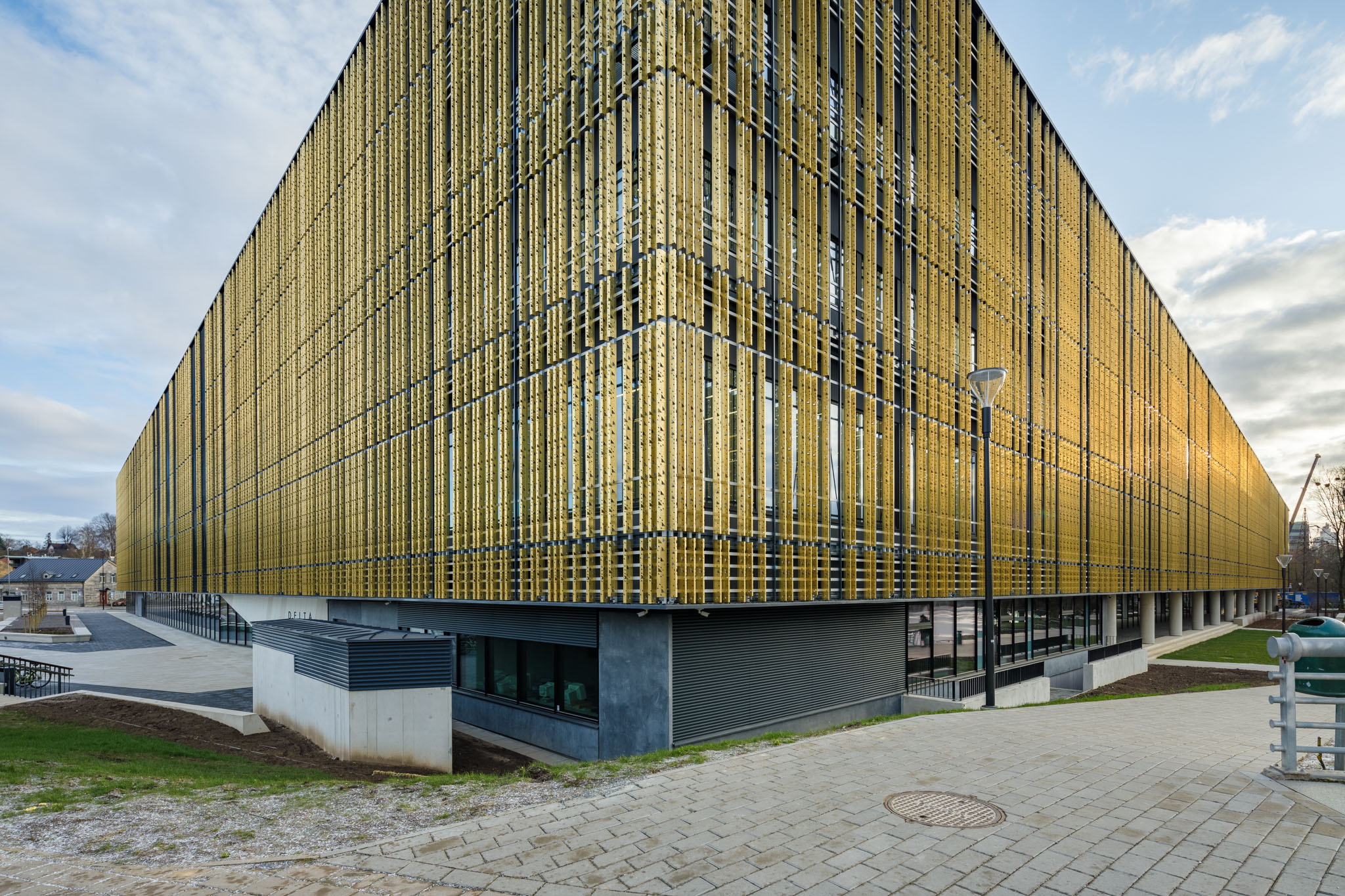 Close view of the corner of the University of Tartu, Estonia. The gold-coloured walls are clad from Nordic Royal copper.