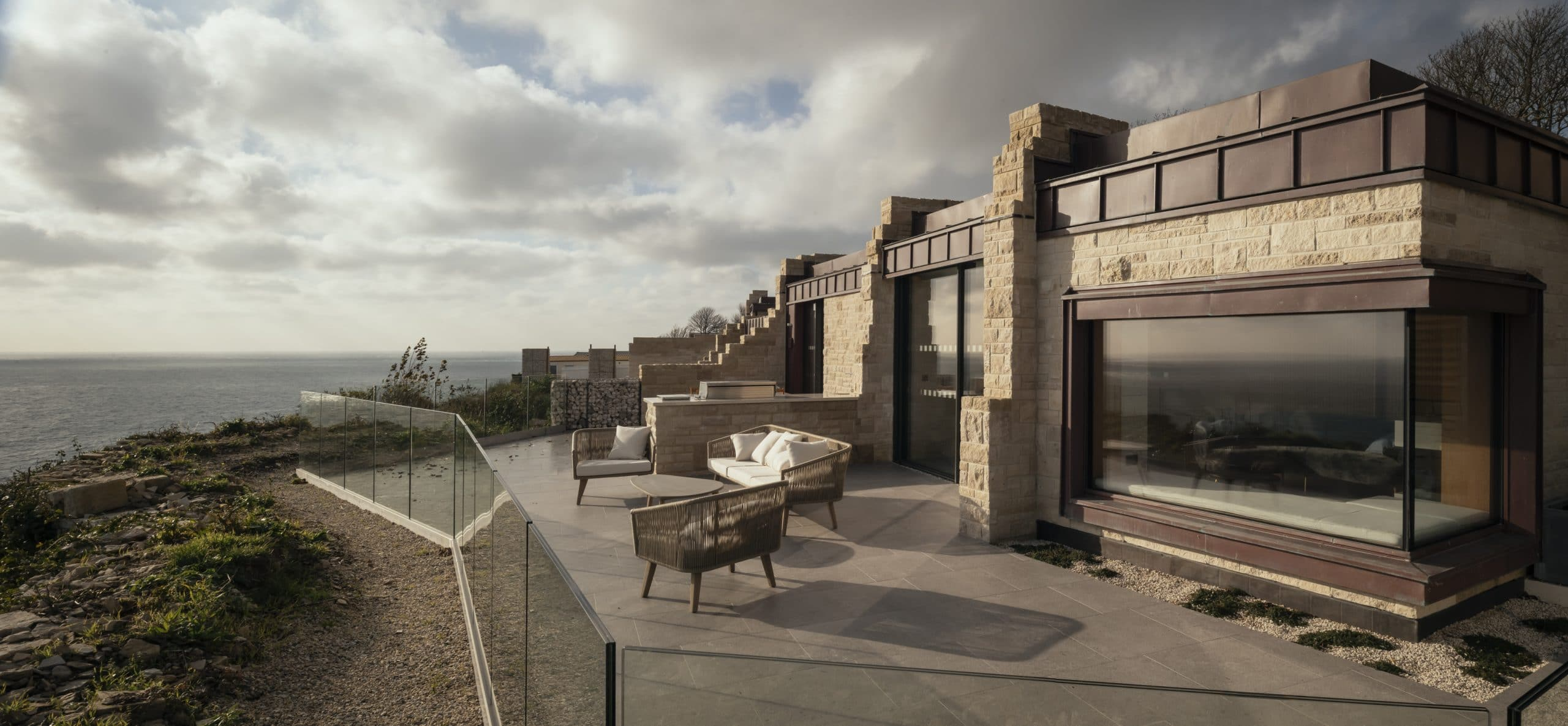 View of the terrace of the Clifftops Holiday Lodges located in the United Kingdom. The copper roofing is clad from Nordic Standard copper.